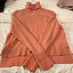 Pink jcrew wool turtleneck with ribbed detail